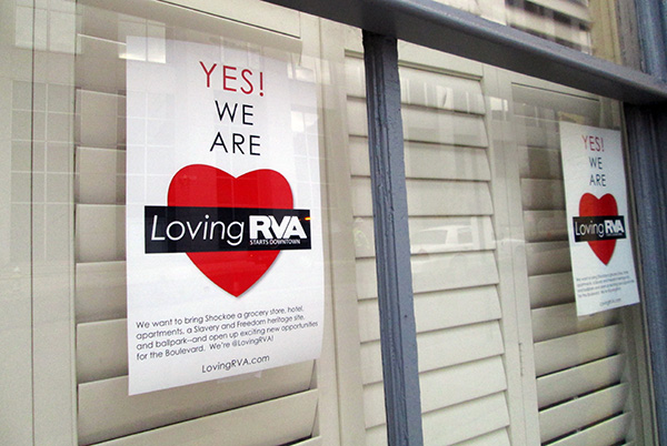 Loving RVA posters are popping up in Shockoe Bottom storefronts. (Photos by Michael Schwartz)