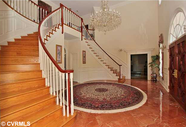 The house's foyer features a large chandelier. (Photos courtesy of CVRMLS)