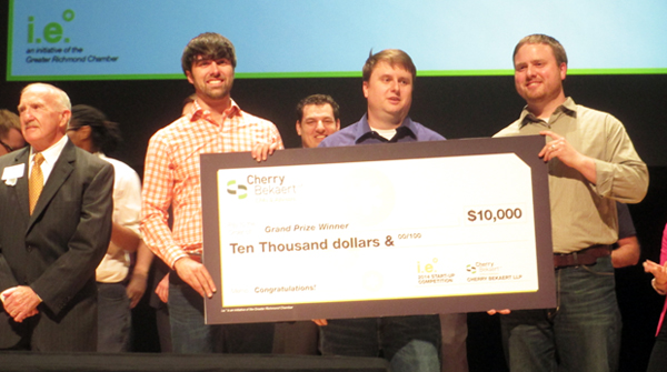 Tenant Turner accepts the $10,000 check for wining the startup contest. (Photo by Michael Thompson.)