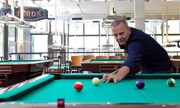 Jim Gottier started playing pool as a teenager and will soon open his first pool hall in the John Marshall building downtown. Photos by Michael Thompson.