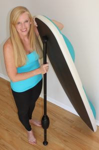 Angie Hardison with a yoga paddle board.