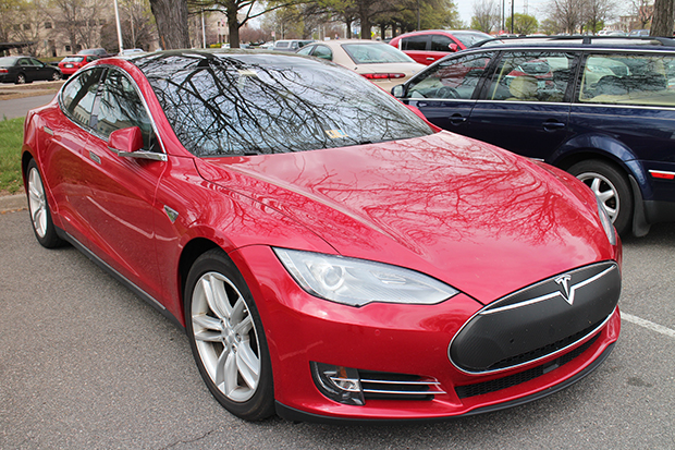 Several Teslas have dotted the DMV parking lot during the hearings. Photo by Linda Dunham.
