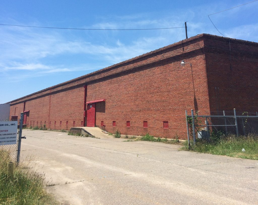 Developers plan to convert the former tobacco warehouse at 1650 Overbrook Road into as many as 117 apartments. (Kieran McQuilkin)