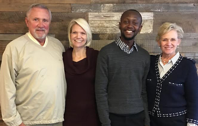 Scholarship recipient Eric Enninful with Brandcenter managing director Don Just, left, and Spurrier president Ingrid Vax and CEO Donna Spurrier, right.