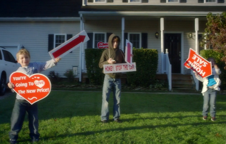 "One RAR commercial shows a homeowner resorting to having children spinning ""for sale"" signs in her front yard."