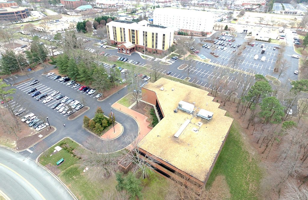 The request could transform a 4-acre parcel at the southeast corner of Innslake Drive and Dominion Boulevard into a mixed-use development. (Kieran McQuilkin)