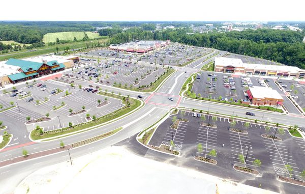The 60-acre Cabela's and Wegmans-anchored West Broad Marketplace sold for $74 million.