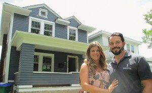 Breese and Josh Romano in front of a home they restored in Richmond's Northside. (Jonathan Spiers)