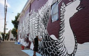 "Last year, ndp had an artist ""tattoo"" the building with a mural as part of its marketing campaign for a Japanese tattoo art exhibit at the Virginia Museum of Fine Arts. (Jonathan Spiers)"