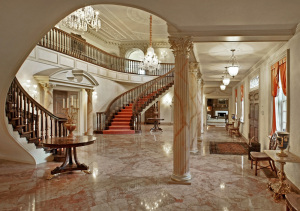There are marble floors and molding and gold features throughout the home.